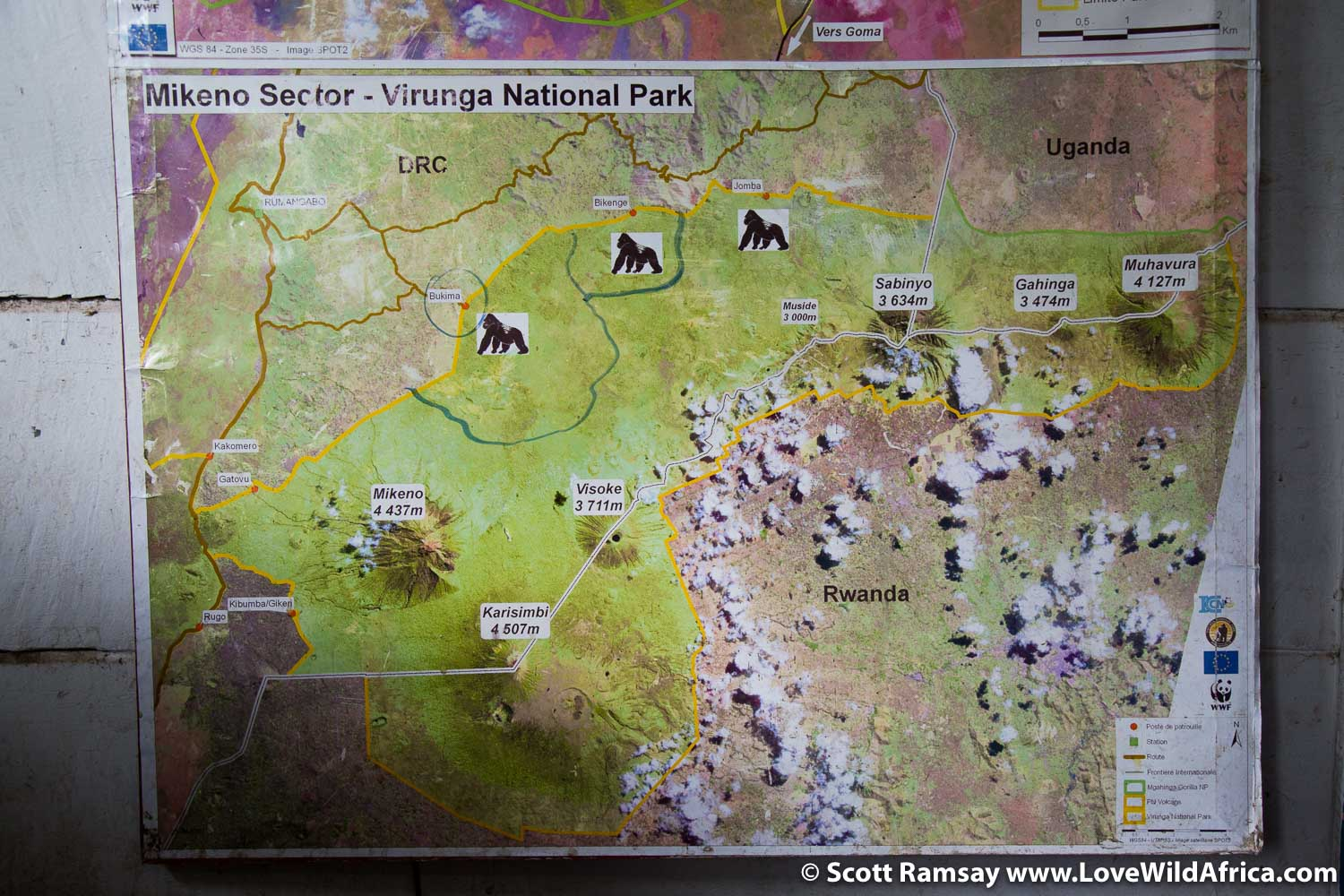 The map on the wall of the ranger post, showing the region, its volcanoes, and where the gorilla families are located.