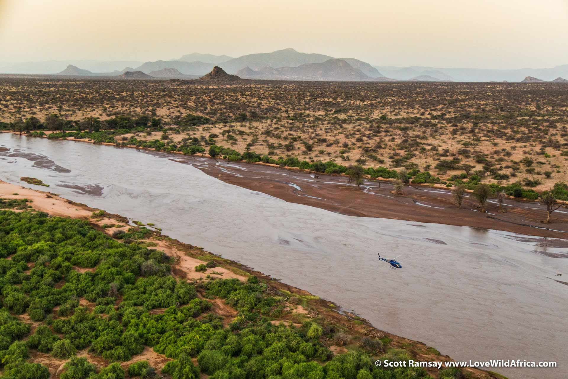 Leaving Sasaab Lodge before sunrise, flying over the Ewaso Ng'iro River.
