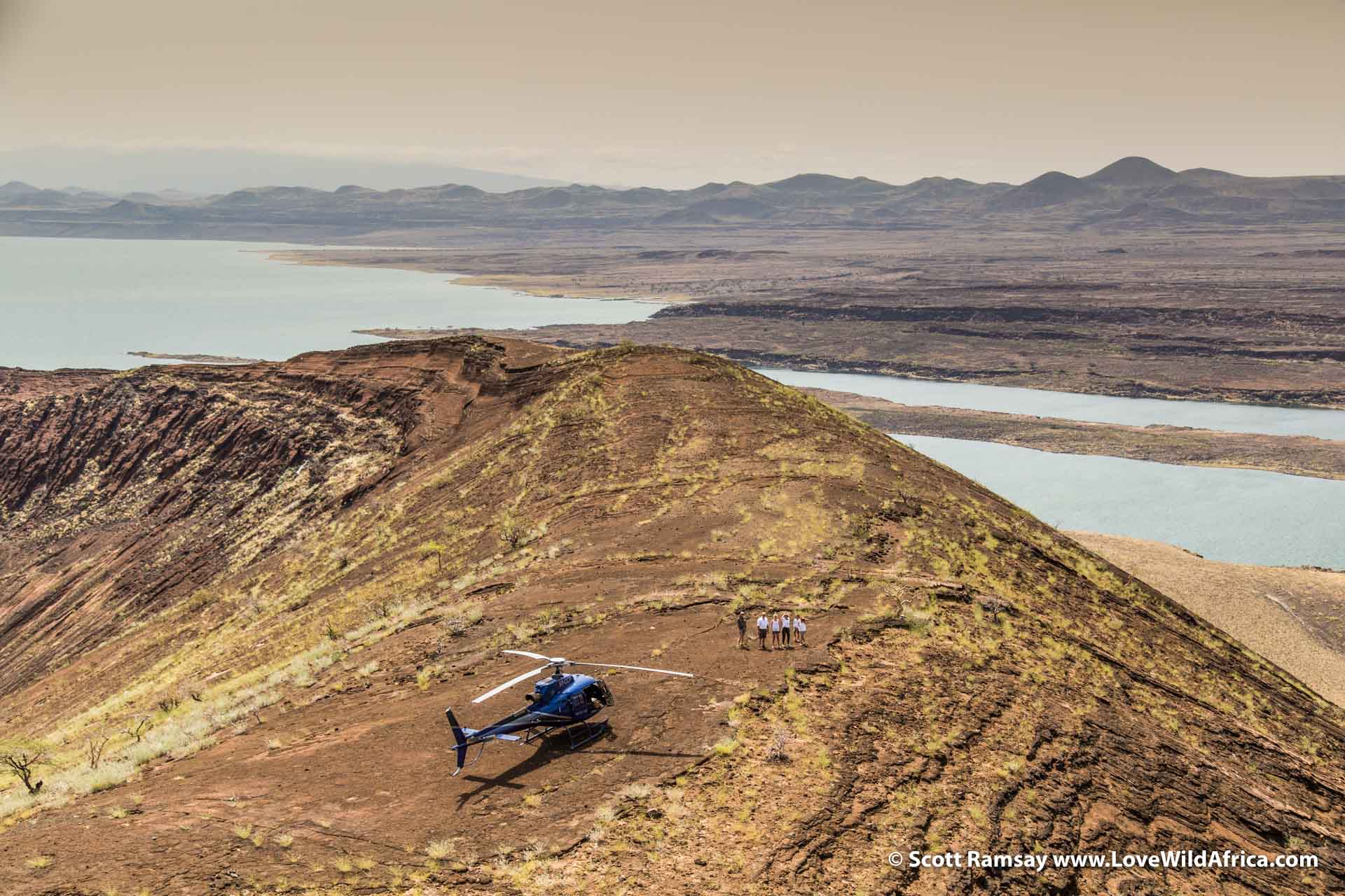 Looking north towards Lake Turkana, with chopper on top of Nabiyotum Crater in the foreground.