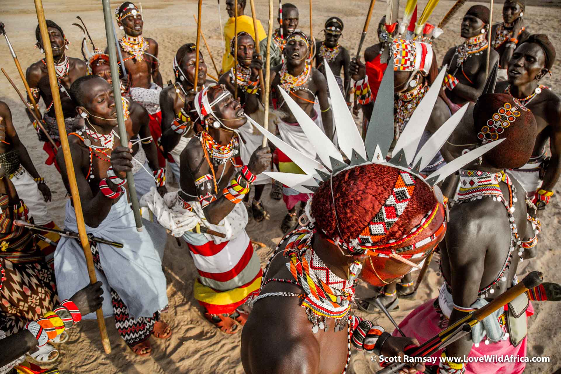 There are infinite photographic opportunities during a Samburu moran dance...its best to have two cameras, one with a wide-angle and another with a telephone lens.